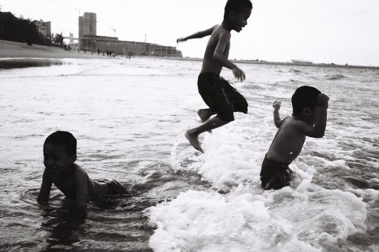 Children playing in sea