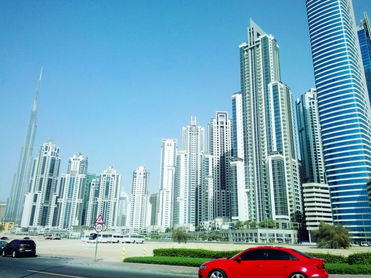 I didn't actually expect that this red car would pass by as i was aiming for thr buildings. But it's a nice contrast! Mobile Photography Streetphotography Buildings Cityscapes Dubai UAE