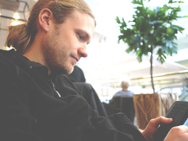 Casual Clothing Close-up Communication Day Face Focus On Foreground Happy Headshot Joy Leisure Activity Lifestyles Longhair Manbun Ordinary Day Outdoors Person Phone Portrait Profile Reading Sms Reading Text Side View Telephone