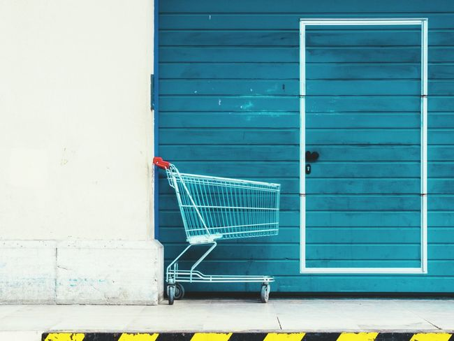 Empty Architecture Building Exterior Day Shopping Cart Retail  Blue Outdoors No People Market Marketplace Still Life Streetphotography Shopping TakeoverContrast Colors Retail  Door Outdoor Minimalist Architecture