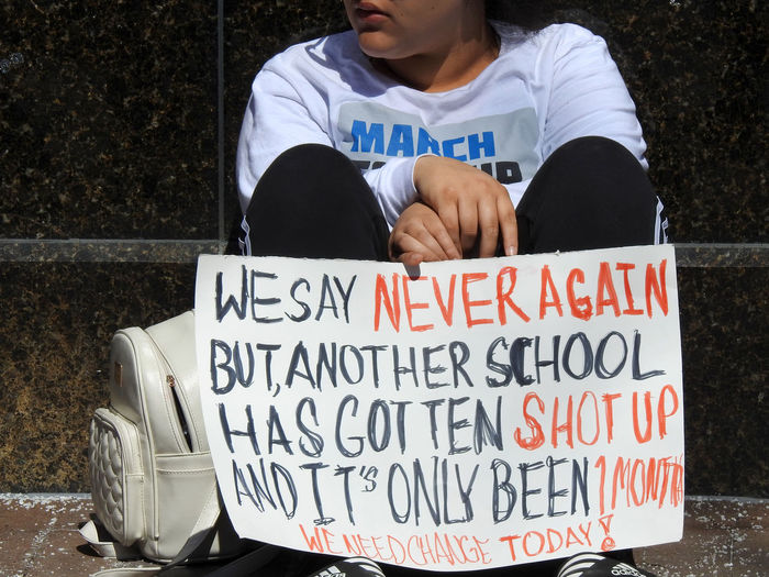 A sign protesting gun violence at schools at the pro- gun control March For Our Lives in Washington, DC on March 24, 2018. Protest Activism Casual Clothing Close-up Communication Day Gun Control Gun Safety Lifestyles March For Our Lives Mass Shooting One Person Outdoors Real People Social Issues Text Western Script