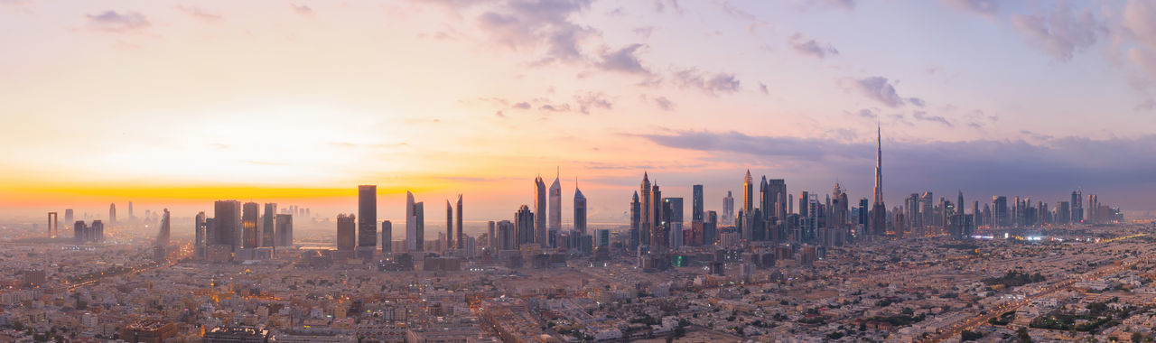 Panoramic view of cityscape during sunset