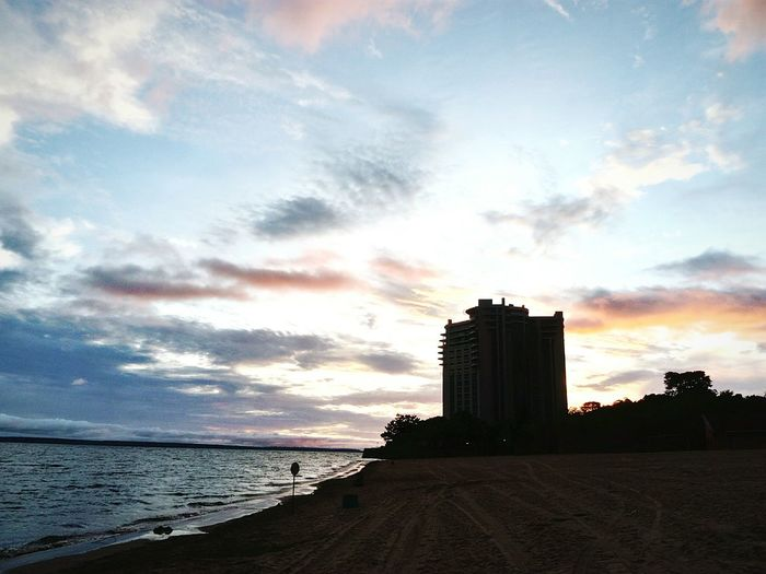 Water Sea Beach Sunset Sky Architecture Building Exterior Horizon Over Water Cloud - Sky