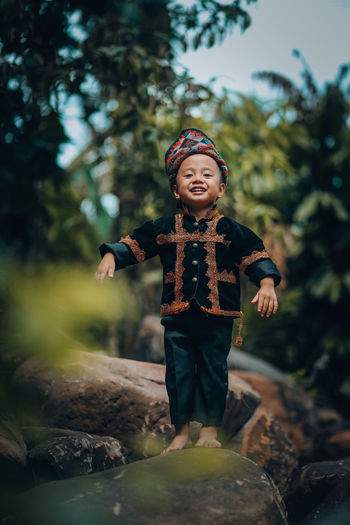 Cute baby boy wearing traditional attire.