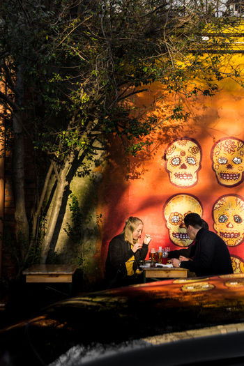 Warmcolors Lights Light And Shadow Golden Hour Outdoors Cafe Coffee Couple Sitting Adult Adults Only Togetherness People Real People Two People Happiness Lifestyles Day