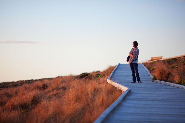 Woman standing on boardwalk