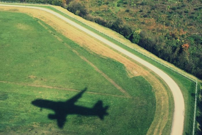 Top Perspective Shadow Landing From Airplane Window Green Shadow Of A Plane Green Color Landscape Day Grass No People Outdoors Trees