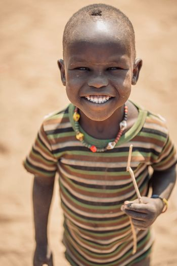 Dassanech Tribe in Omorate - Ethiopia Child Ethiopia Ethiopian Dassanech Tribe Portraiture African Village Omo Valley Omovalley Portrait Photography Ethiopian Photography 🇪🇹 Looking At Camera Smiling Portrait Childhood One Person Front View Child Emotion Innocence Hairstyle Lifestyles Real People Waist Up Happiness