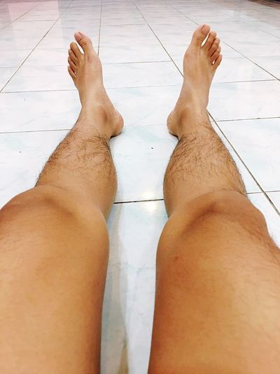 Legs and foots Low Section Human Leg Human Foot Barefoot Human Body Part Tiled Floor Standing Lifestyles Leisure Activity Real People Women One Person Close-up Indoors  Feet Day People