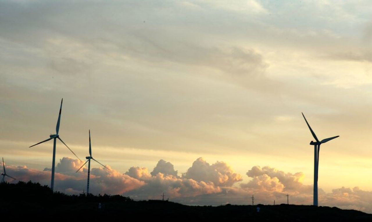 SILHOUETTE OF WINDMILL AGAINST SKY AT SUNSET