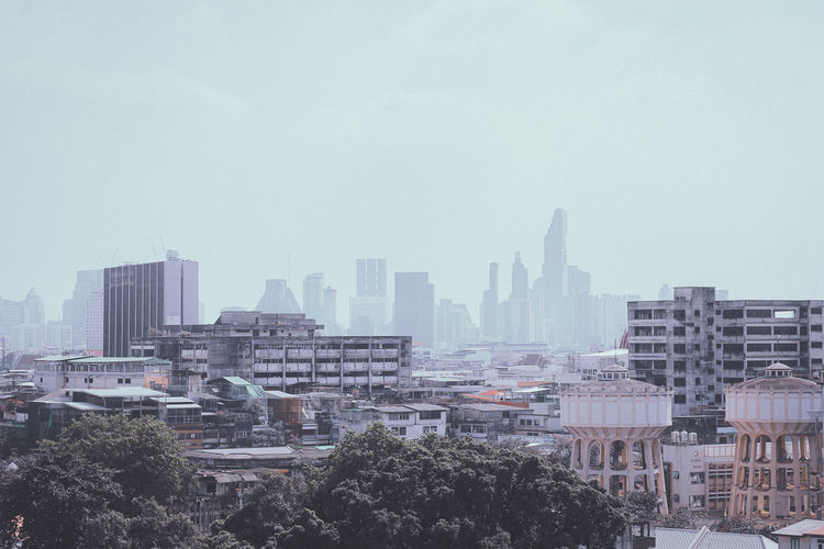 Downtown bangkok city hidden in a veil of smog in the early morning
