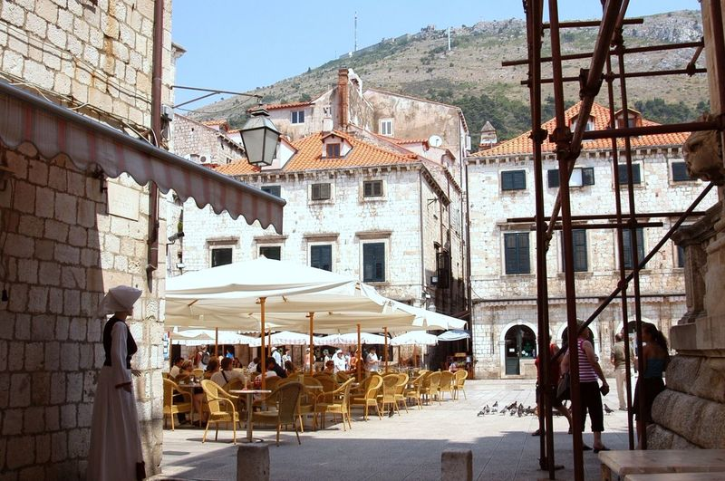 Chairs and table against buildings on sunny day
