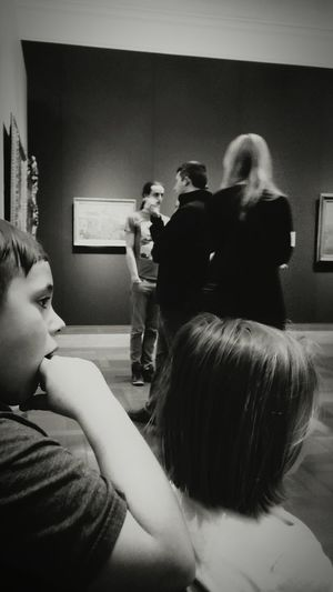 Indoors  Togetherness Rear View Arts Culture And Entertainment Leisure Activity Black And White Photography Architecture Art Gallery Art Museum EyeEm Gallery Irwin Collection Brother And Sister Bond Children Learning Black & White Photography Welcome To Black The Photojournalist - 2017 EyeEm Awards Let's Go Smarter