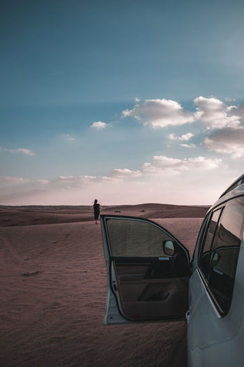 View of car on land against sky during sunset