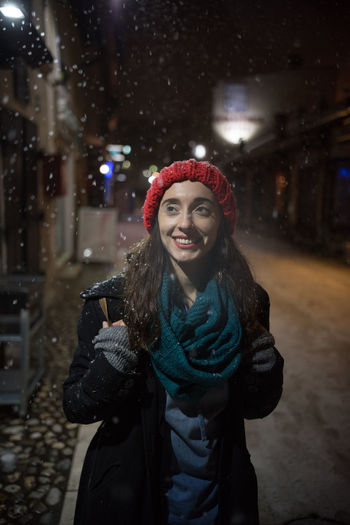 Woman Standing On Road Against Sky During Snowfall