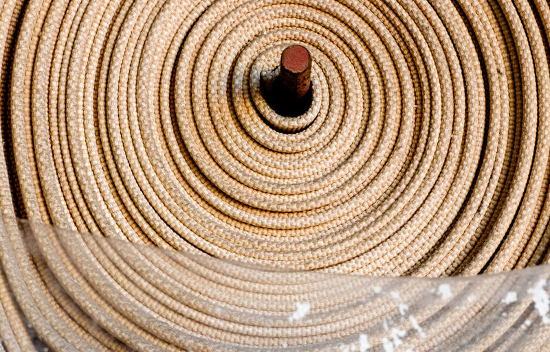 An unused fire hose in my building, little worried about how useful it could actually be... Backgrounds Circle Close-up Color Colour Concentric Fire Hose Geometric Shape Material Pattern Textile