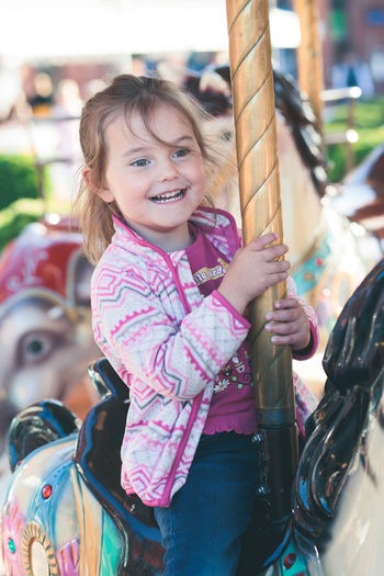 Little adorable smiling girl riding a horse on roundabout carousel at funfair Childhood Child One Person Portrait Smiling Real People Happiness Outdoors Innocence Girl Little Enjoying Having Fun Adorable Amusement Park Amusement  Authentic Authentic Moments Candid Carnival Carousel Horse Funfair Happy Happiness Merry Park Playing Joy Joyful Playground Cute Riding Ride Roundabout Summer Season