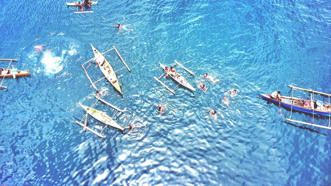 High angle view of outrigger boat in blue sea