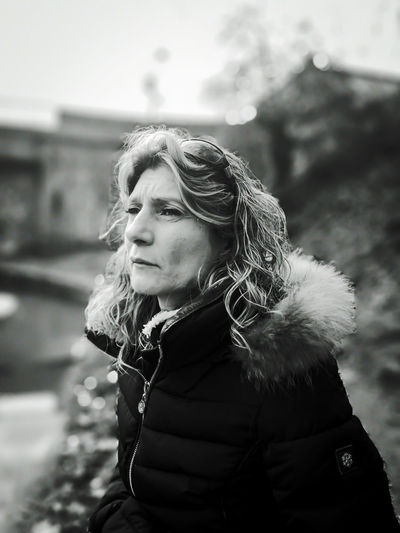Mature woman looking away outdoors during winter