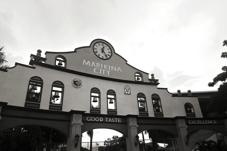 Marikina City, Philippines Eyeem Philippines Architecture Arch History Built Structure Travel Destinations Ancient City Gate Building Exterior Low Angle View Day Outdoors Clock Sky No People Politics And Government Clock Face Communication Bridge - Man Made Structure Text Cloud - Sky