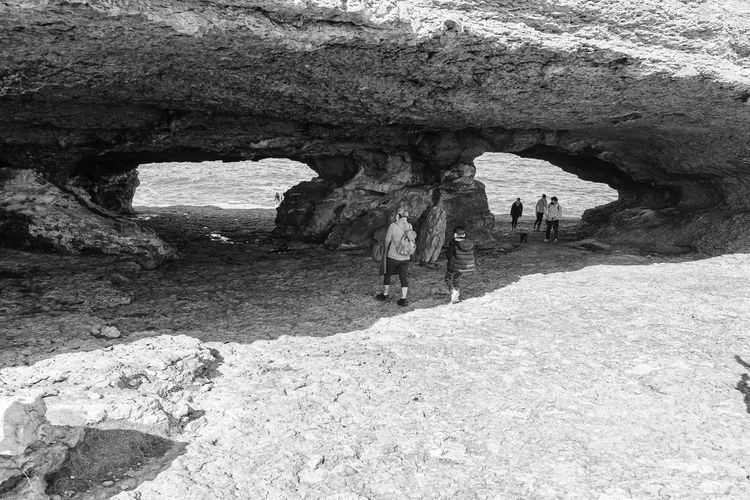 People on rock formation