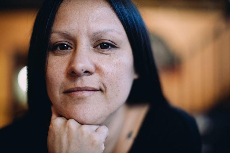 Adult woman looking at camera.
