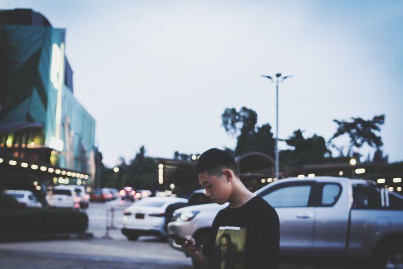 Full length of man on street in city against sky