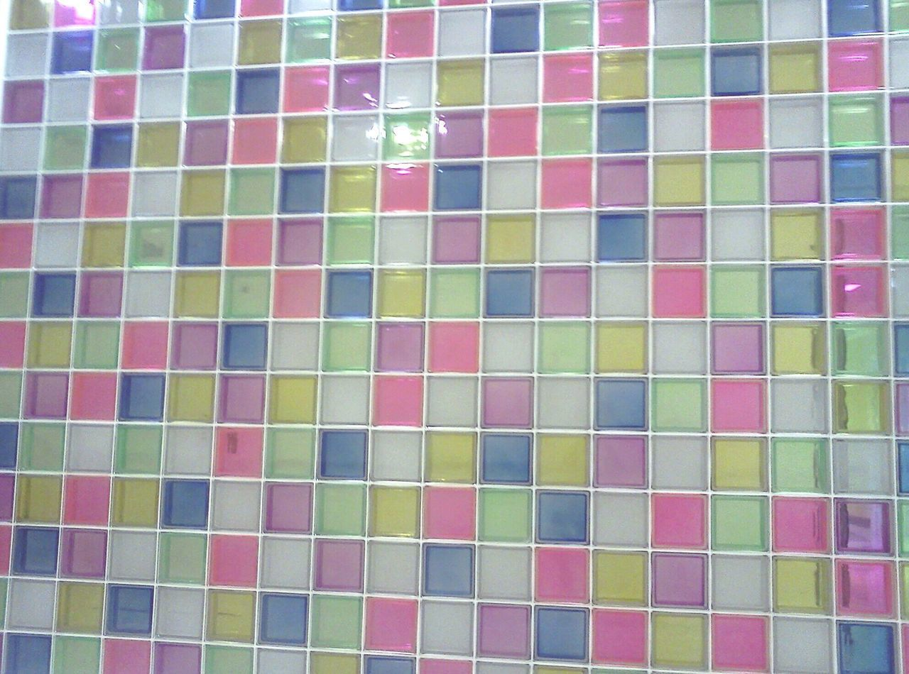 FULL FRAME SHOT OF MULTI COLORED TILED WALL