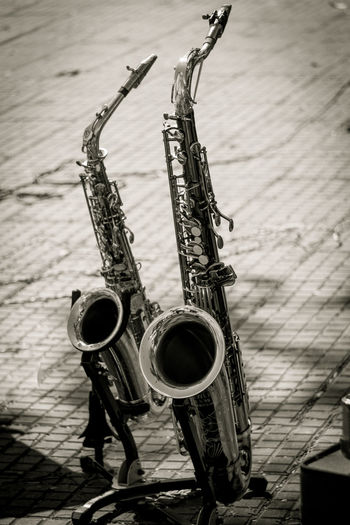 Saxophones on footpath