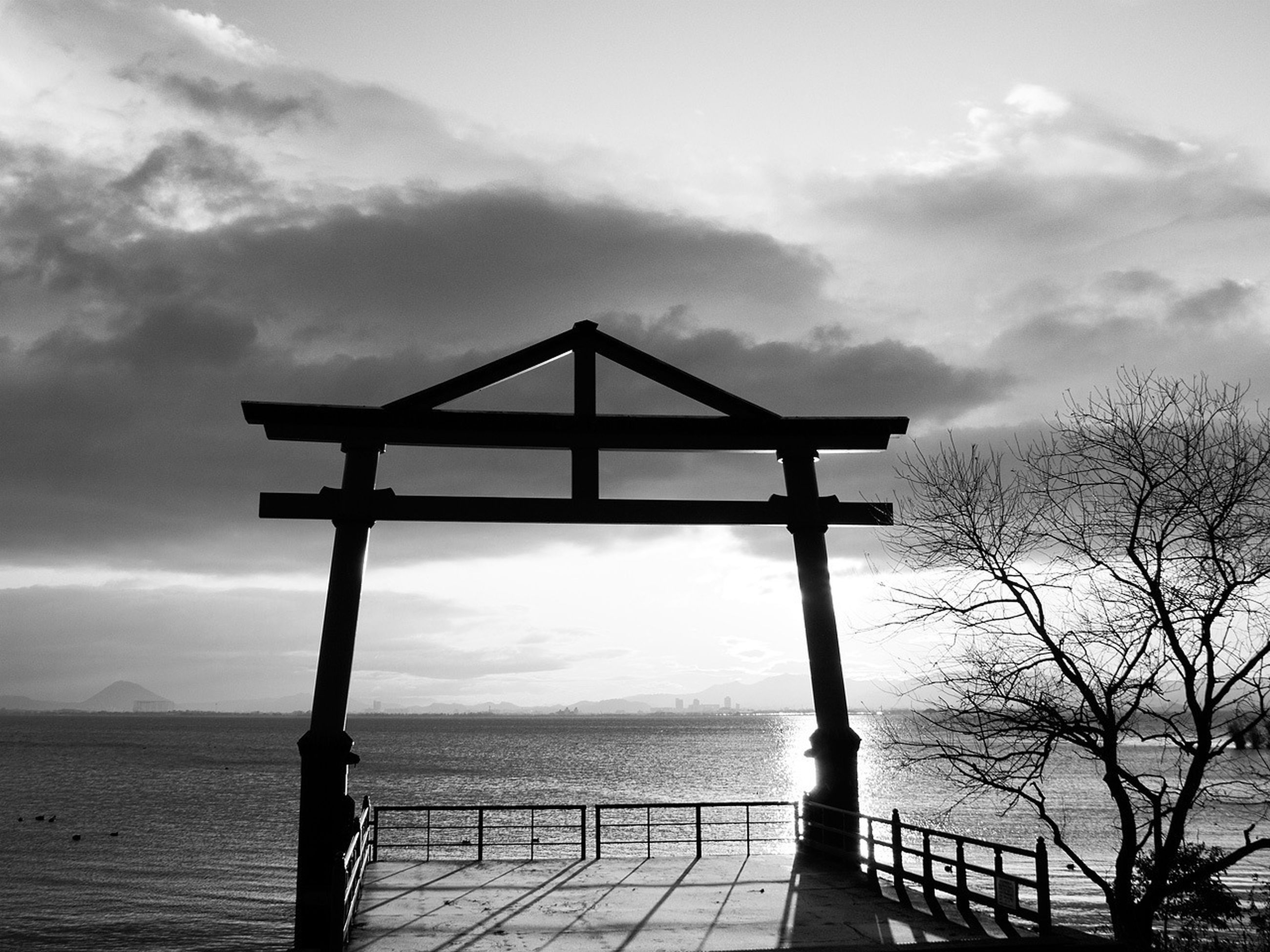 sky, water, tranquility, sea, cloud - sky, tranquil scene, scenics, silhouette, horizon over water, nature, beauty in nature, pier, cloud, wood - material, cloudy, gazebo, idyllic, sunset, railing, no people