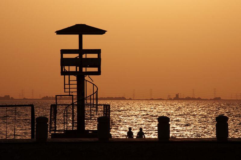 Beach Lifeguard Hut Outdoors Sea Silhouette Sky Sun Sunset Vacations Water