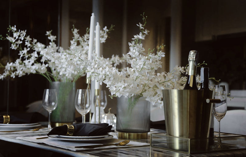 Flowers in glass vase on table at home