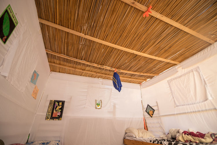 Low angle view of clothes hanging on ceiling at home