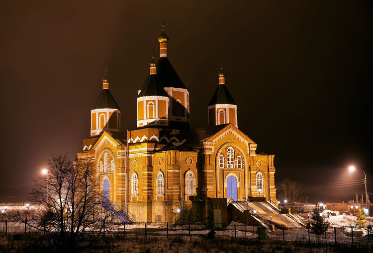 Church against sky at night