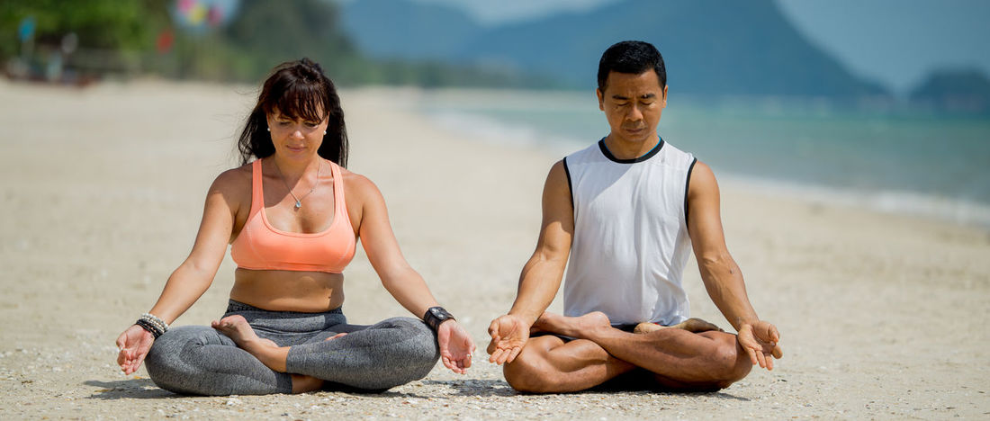 Adult Balance Cross-legged Day Exercising Flexibility Friendship Healthy Lifestyle Lifestyles Lotus Position Meditating Men Nature Outdoors Relaxation Relaxation Exercise Sitting Sport Sports Clothing Togetherness Two People Wellbeing Yoga Young Adult Zen-like
