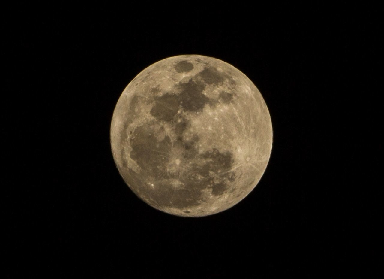 moon, space, night, astronomy, sky, planetary moon, moon surface, geometric shape, beauty in nature, circle, no people, full moon, shape, nature, tranquility, low angle view, copy space, scenics - nature, clear sky, outdoors, dark, moonlight, astrology, space and astronomy, eclipse