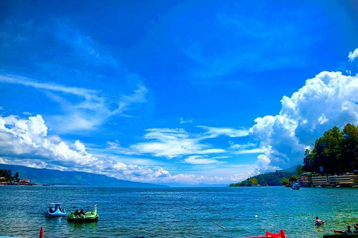 Water Blue Nautical Vessel Sea Vacations Sky Outdoors Cloud - Sky Beach Travel Destinations Tourist Resort Beauty Day Scenics Nature Beauty In Nature Mountain People Tree Adult Parapat LakeToba  INDONESIA