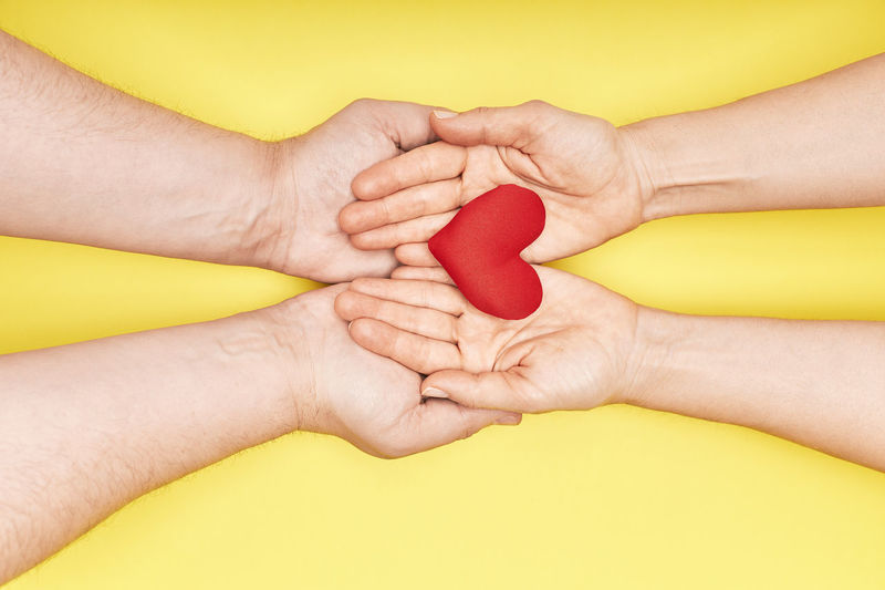 Close-up of hands holding heart shape