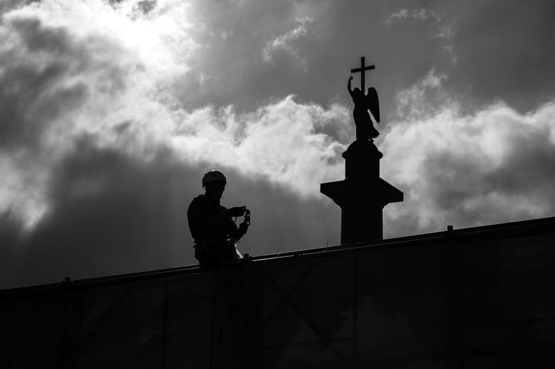 Cloud - Sky Sculpture Sky Statue Representation Human Representation Low Angle View Art And Craft Male Likeness Architecture Silhouette Creativity Nature Built Structure Day No People Craft Memorial Religion History Angel At Work Working