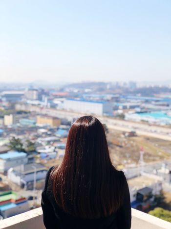 Iphonephotography IPhoneX Eyeemphotography EyeEm Best Shots Korean Korea Gwangju Rear View Long Hair Real People Focus On Foreground Cityscape Women One Person Outdoors City Sky Standing Building Exterior