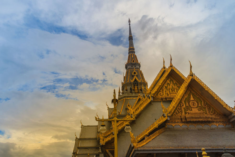 Beautiful Thai's style craving and decoration on the golden gable end at Wat Sothonwararam, a famous public temple in Chachoengsao Province, Thailand. Buddhism Temple Chachoengsao Chachoengsao Province Cloudy Day Cloudy Sky Dramatic Sky Gable End Golden Temple Thai's Style WAT Sothon Wara RAM Worawihan (WAT Luang PHO Sothon) Wat Sothon Wat Sothon Wararam Worawihan Buddhist Temple Cloudy Sunset Cloudysky Dramatic Landscape Dramatic Skies Gable Gable Roof Gable Temple Naga Gables Golden Gable Wat Sothonwararam White Clouds And Blue Sky