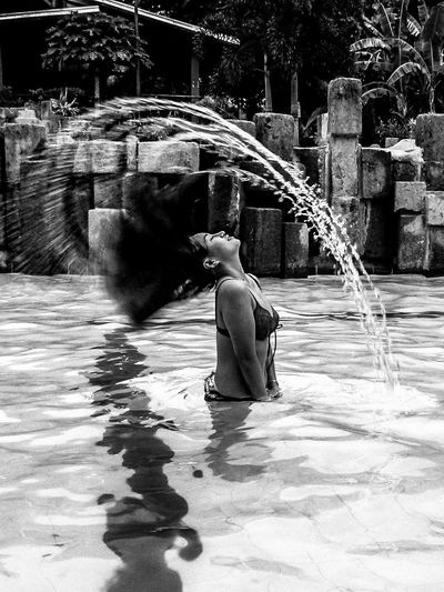 Hair Flip... Water Real People One Person Motion Full Length Black And White Adults Only Woman Hair Flip Hair Pool Outdoors Spray Swimwear Fashion Mermaid Shot Two Piece Face Splatter Live For The Story Eyeem Philippines The Portraitist - 2017 EyeEm Awards