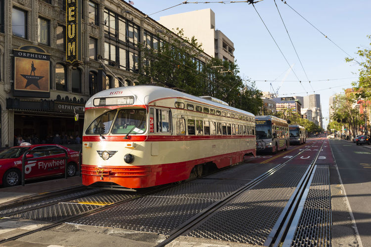 San Francisco Historic Street Car at sunset Antique Architecture Building Bus Cable California Car City Cityscape Day Electric Famous Francisco Historic MUNI Old Outdoor Passenger People Public Rail Railway Red Retro Road San SF Sky Street Streetcar Summer Tourism Tourist Town Track Traffic Train Tram Tramway Transit Transport Transportation Travel Trolley Urban USA Vehicle View Vintage