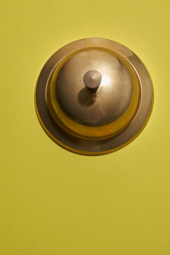 Directly above shot of tea light against yellow background