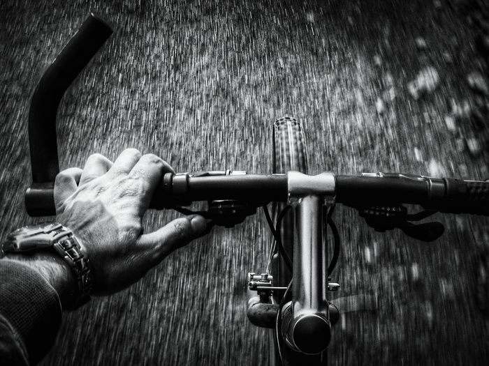 Human hand riding by bicycle