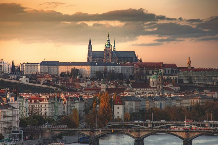 Sunset over prague, view of city and river