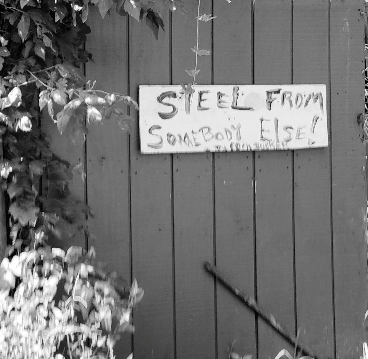 INFORMATION SIGN ON WOODEN DOOR