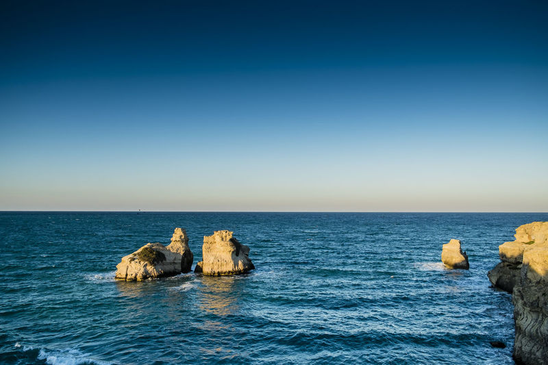 Two Sisters - Melendugno - Lecce - Italy Beach Beauty In Nature Blue Coast Day Horizon Over Water Italy Landscape Nature Nature No People Outdoors Rock Formation Rocks Salento Scenics Sea Sky Summer Tranquil Scene Travel Travel Destinations Travel Photography Water Waves, Ocean, Nature