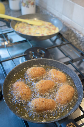 frying rice croquettes in boiling oil Frying Pan Arancine Arancini Boiling Crisp Croquette Croquettes Frying Oil Rice