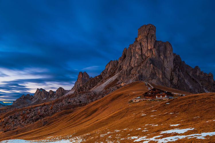Passo Giau, Dolomites Dolomites Beauty In Nature Cloud - Sky Cottage Day Environment Geology Hut Idyllic Italy Landscape Long Exposure Mountain Mountain Peak Mountain Range Nature No People Rock Rock Formation Scenics - Nature Sky Snow Tranquil Scene Tranquility Travel Destinations